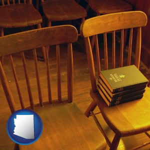 wooden chairs and hymnals in an old church building - with Arizona icon