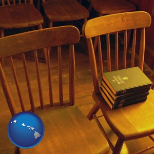 wooden chairs and hymnals in an old church building - with Hawaii icon
