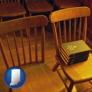 wooden chairs and hymnals in an old church building - with Indiana icon