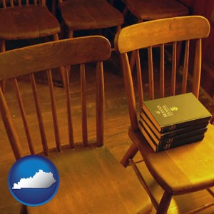 wooden chairs and hymnals in an old church building - with Kentucky icon