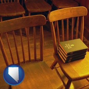 wooden chairs and hymnals in an old church building - with Nevada icon