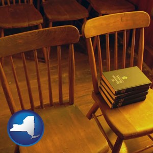 wooden chairs and hymnals in an old church building - with New York icon