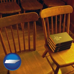 wooden chairs and hymnals in an old church building - with Tennessee icon