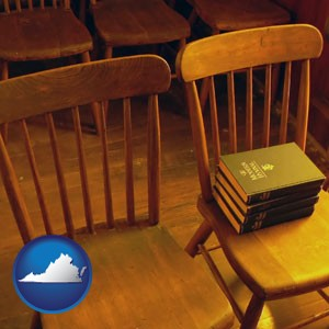 wooden chairs and hymnals in an old church building - with Virginia icon