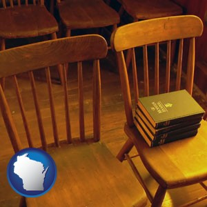 wooden chairs and hymnals in an old church building - with Wisconsin icon